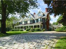 The home sits on a 13.8-acre lot in the exclusive Rye Beach Village.