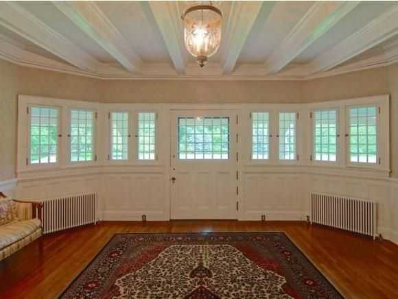 A look at the home's lovely high-beamed ceilings and baronial foyer.