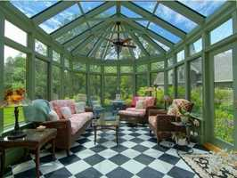 The home has a conservatory that overlooks exquisite greens and gardens.