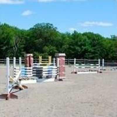 The home also has an outdoor arena.