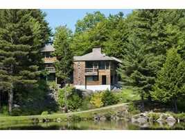 The home sits on 1,318 acres of land along the shores of Upton Pond.