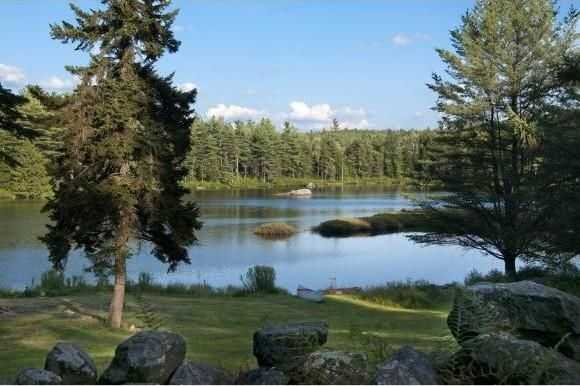 The pond, approximately 8 to 12 feet deep, is excellent for swimming, canoeing, kayaking, fishing and ice skating.