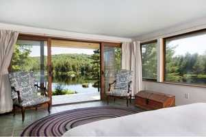 One of the home's three bedrooms has a stunning view of the pond.