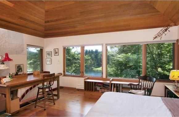 This bedroom features hardwood floors and elegant mahogany trim.