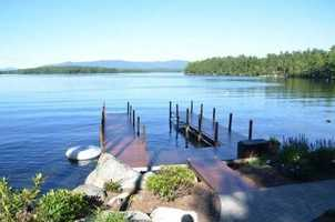 The home on Powers Road is located on the shore of Lake Winnipesaukee.