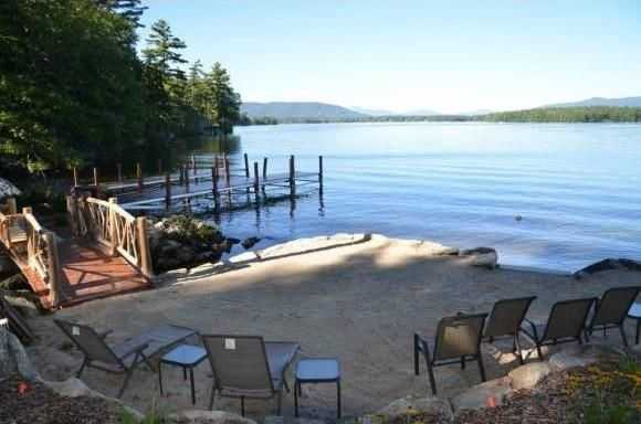 The home has a private beach with a u-shaped dock.