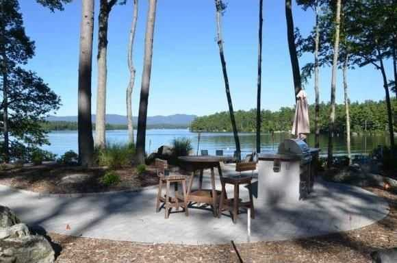 A spacious patio with a summer kitchen allows one to enjoy evening meals at the waters edge.