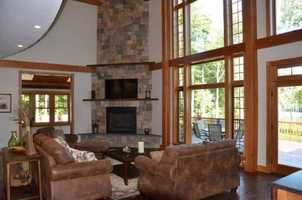The home's main living area has a large stone fireplace.