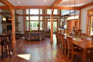 The main living and dining area has hardwood floors throughout.