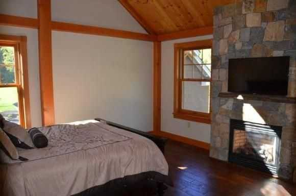One of the bedrooms has a stone fireplace.