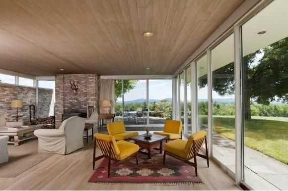 The home has east and south walls of glass to take in the sweeping mountain views.