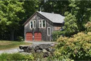 A 1,242 square foot carriage house has a two-car garage has 2 bedrooms and 1.5 bathrooms.