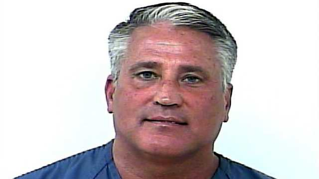 County commissioner Chris Dzadovsky is accused of stealing a pool heater from a home last month.