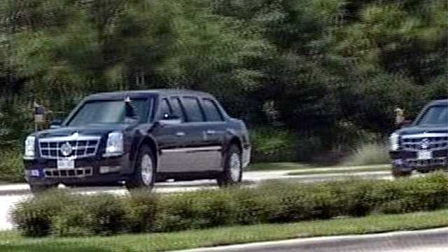 The motorcade reaches Palm Beach Gardens.