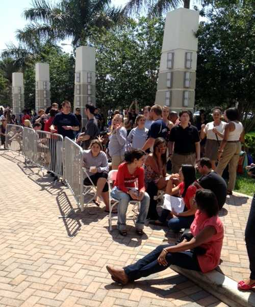 Students at FAU wish for shade as they wait for President Obama's arrival. (Desiree Malky/WPBF)