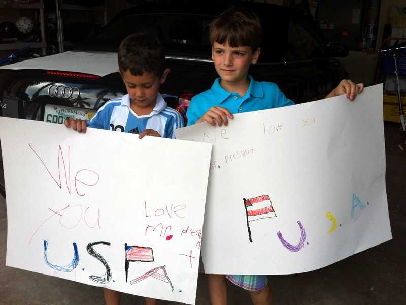 Children who live in the Palm Beach Gardens neighborhood where the fund-raiser was taking place show their excitement.