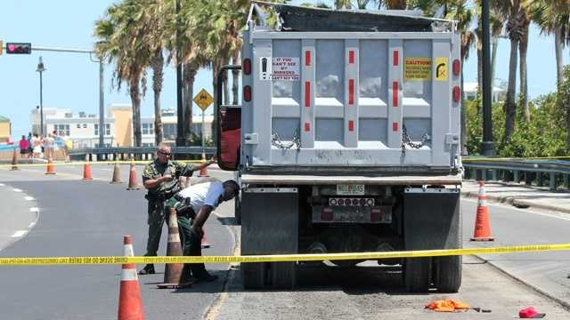 A worker was killed after this dump truck backed over him in Deerfield Beach. (Mike Jachles/Broward Sheriff's Office)