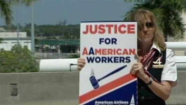 Flight attendants for American Airlines protest proposed cuts outside Palm Beach International Airport.