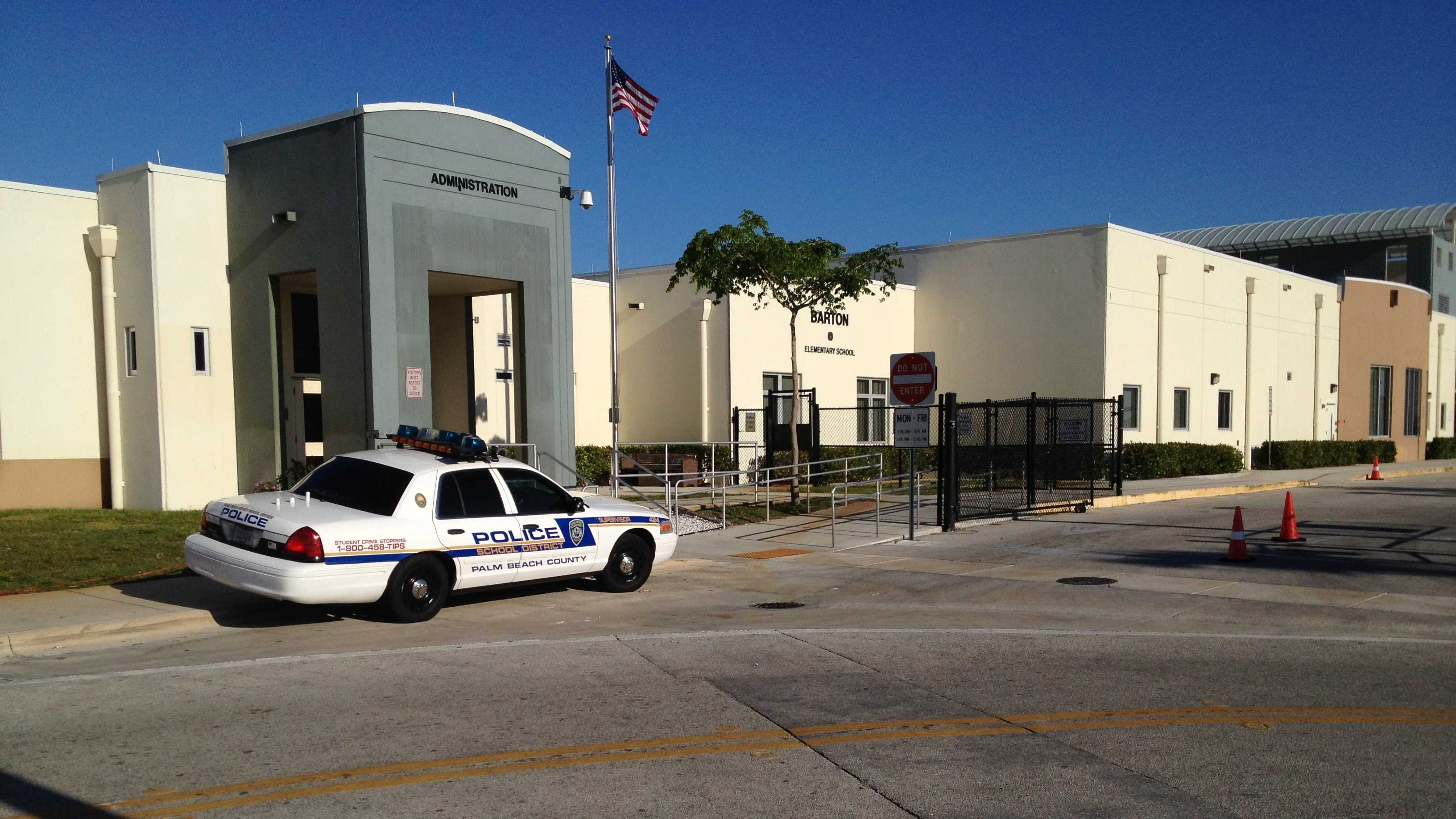 Police say two loaded guns were found in a student's backpack at Barton Elementary School.