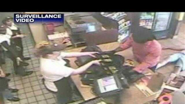 Newly released surveillance video shows a violent armed robbery at a Dunkin' Donuts in Boynton Beach.
