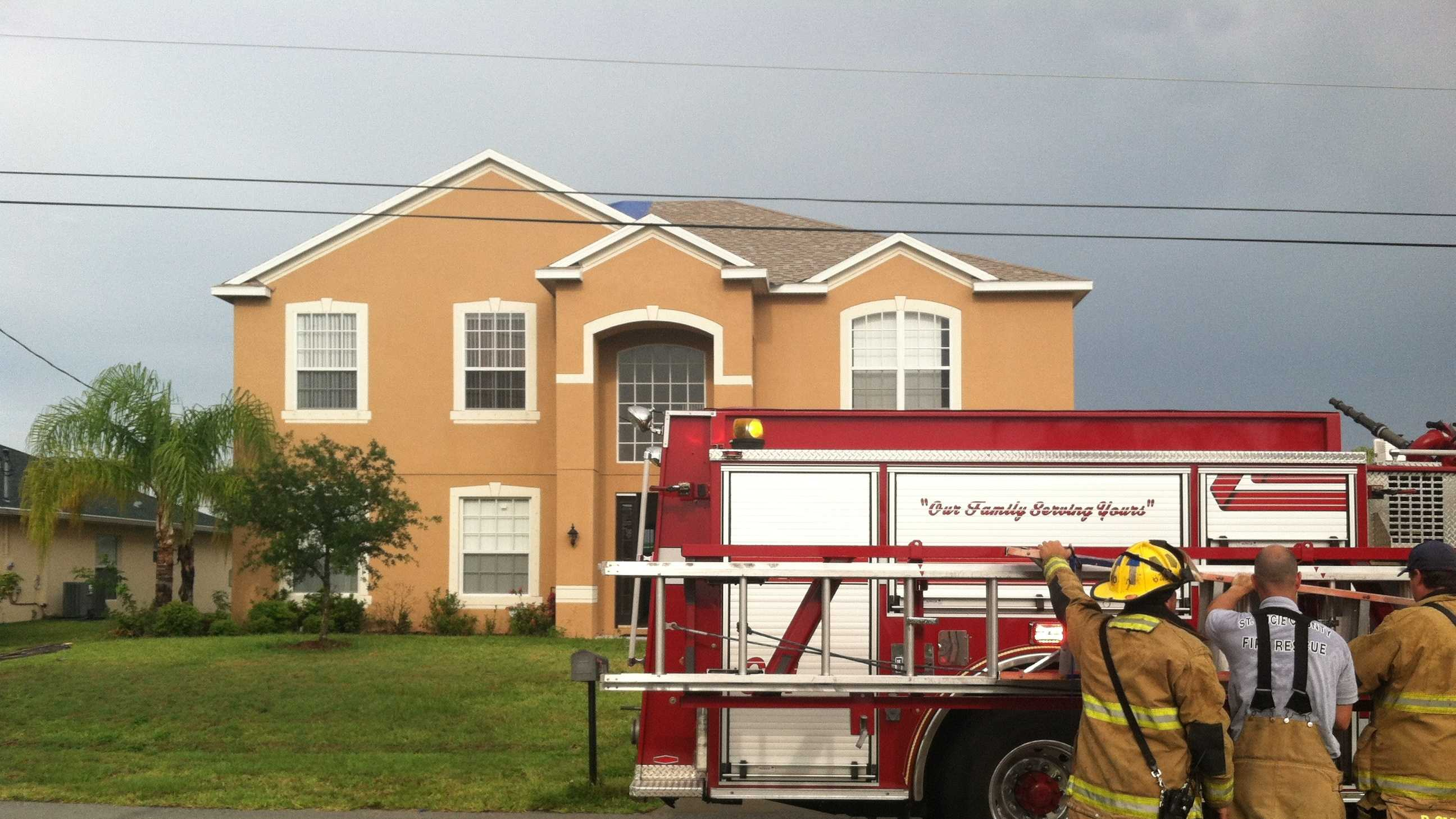 Firefighters say lightning struck this house in Port St. Lucie, causing the roof to catch on fire. (Erin Guy/WPBF)