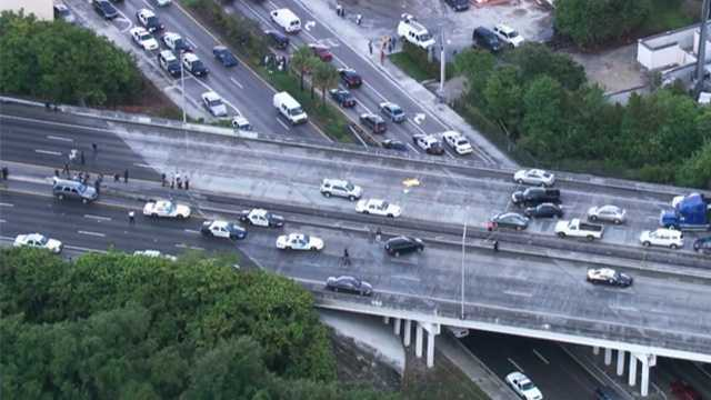 Authorities say two officers were shot on Florida's Turnpike in Broward County before the gunman fatally shot himself.
