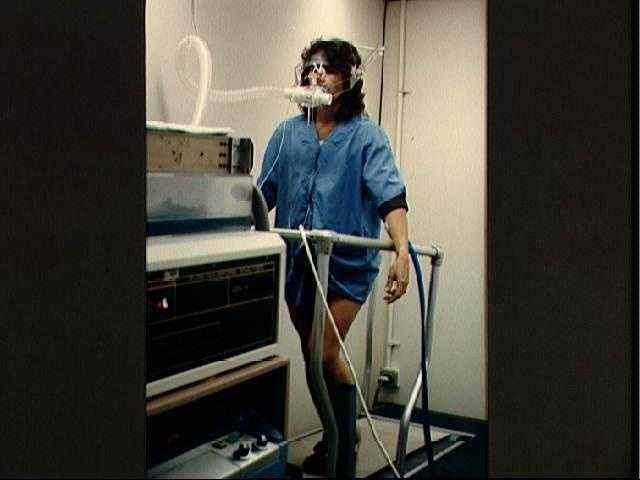 Christa McAuliffe runs in place on a treadmill to test physiological response