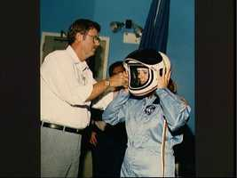 Payload specialist Christa McAuliffe briefed on launch/entry helmets