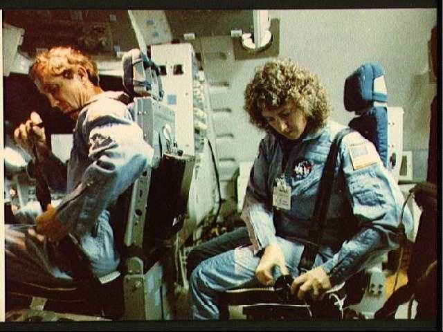 Christa McAuliffe straps in to seat in Shuttle Mission Simulator