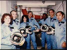 Crew pose for portrait while training at KSC