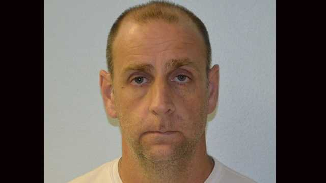 Police say Mark Moore exposed himself Saturday at a beach.