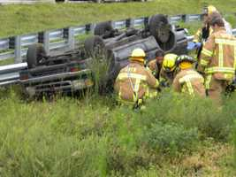 Delray Beach firefighters rescued two people from a pickup truck that overturned on Interstate 95.