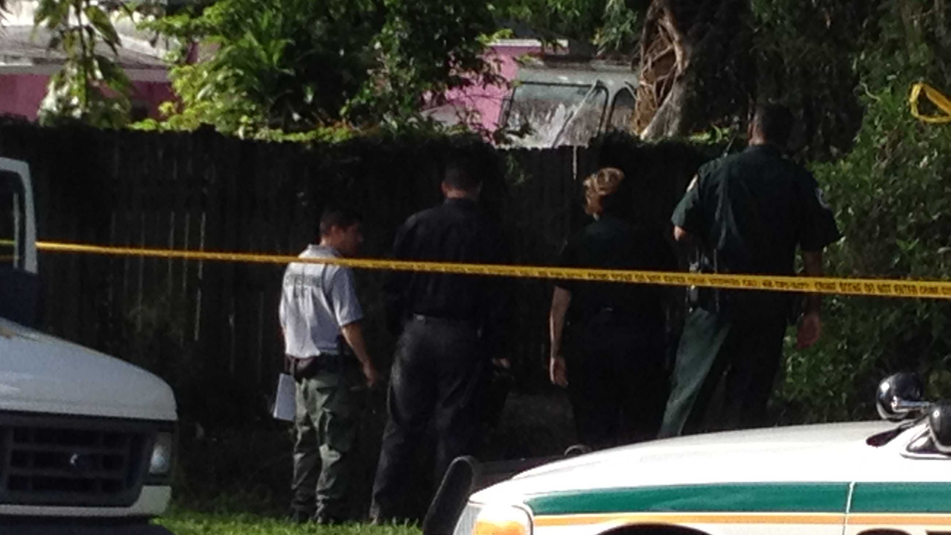 Sheriff's deputies investigate after a body is found in a canal in West Palm Beach.