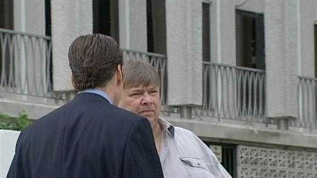 David Milstead talks to his attorney outside the federal courthouse in West Palm Beach.
