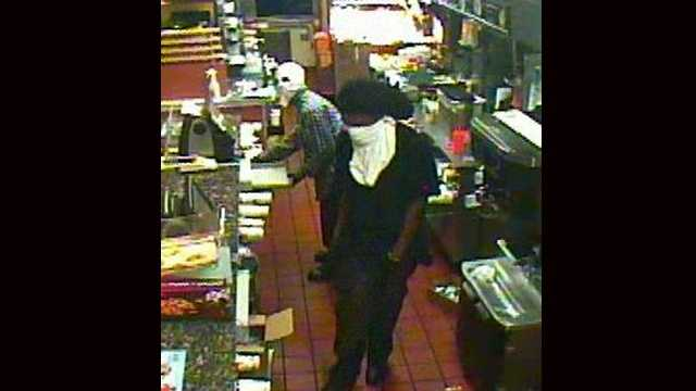 Two masked gunmen robbed a McDonald's in Oakland Park late Saturday night.
