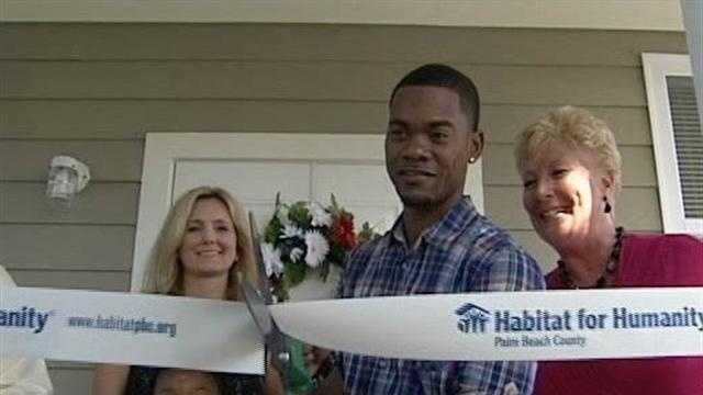 Army veteran Jermaine Scott and his daughter, Kira, get the keys to their new home in Lake Worth.