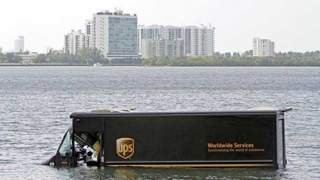 A UPS truck ended up in Biscayne Bay this week. The driver is OK. (Photo courtesy Walter Michot/Miami Herald)