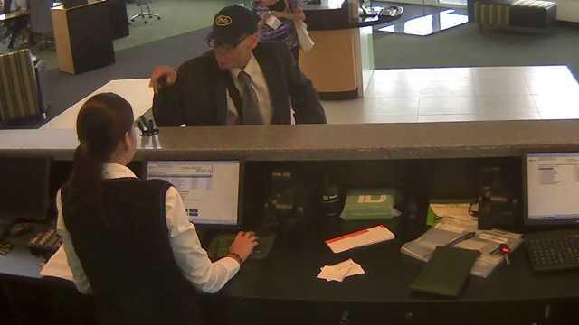 070512 Surveillane well-dressed bank robber