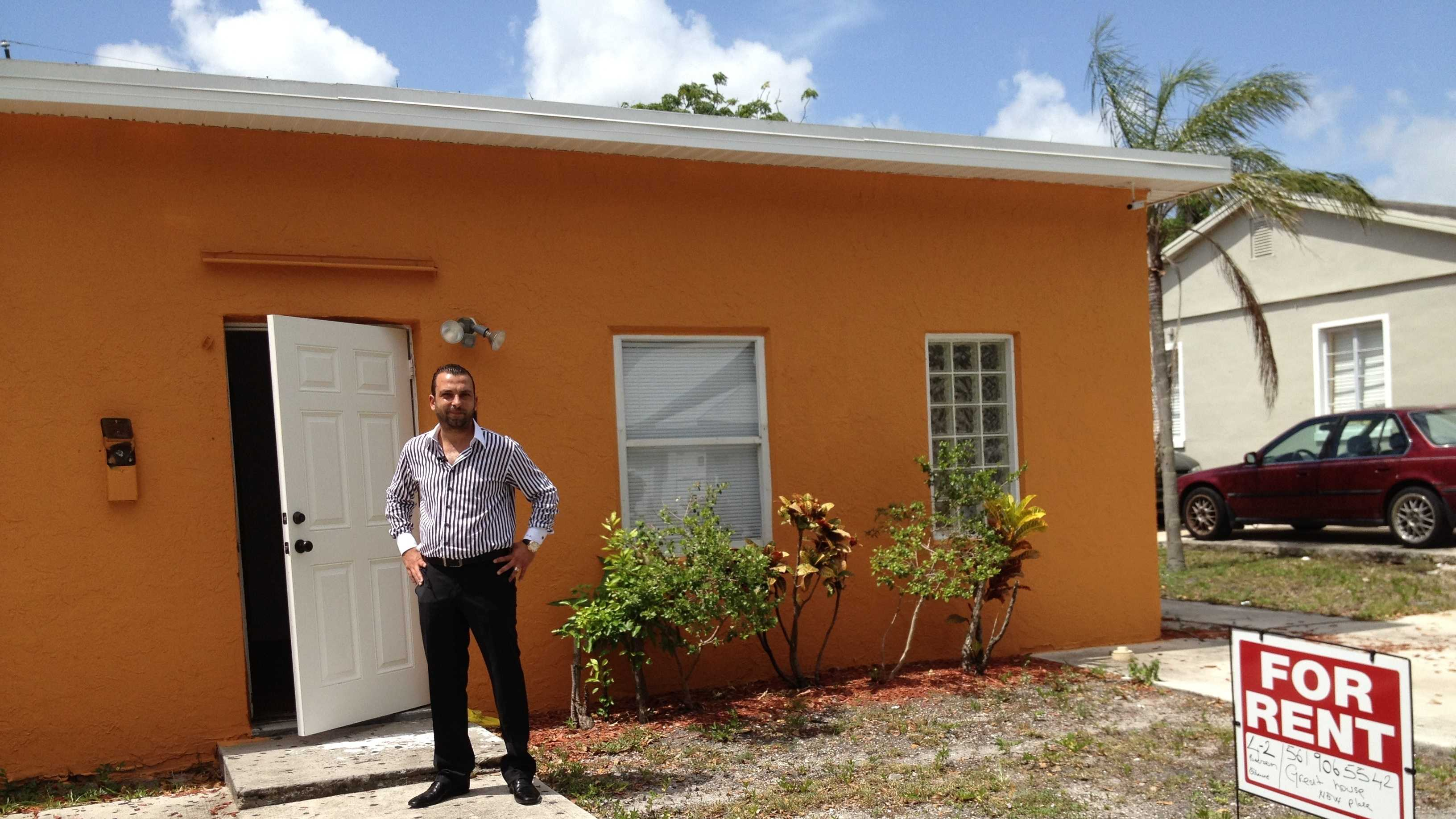 Erdem Altinok, who owns 22 rental units, stands outside his newly renovated property north of downtown West Palm Beach.