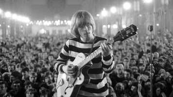 """Brian Jones, pictured here in 1964, was an integral member of the Rolling Stones in their early days, but his deficiencies as a songwriter and his increasing drug addiction relegated his role with the band. Jagger and Richards began to take center stage, further sinking Jones into a dark abyss. After his second drug arrest, he was unable to obtain a work visa to travel out of the country, effectively ending his stint with the band. Jones announced he was leaving the band in June 1969, citing a rift with his bandmates. Privately, however, he was asked to leave. Jones became the first rock star to die at the age of 27 when his body was found at the bottom of his swimming pool July 3, 1969. Conspiracy theorists still speculate as to whether his drowning was more than an accident. The last album he recorded with the Stones was """"Let It Bleed."""""""