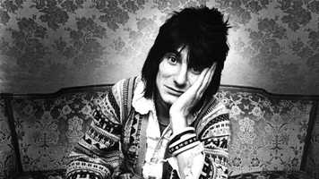 Ronnie Wood, pictured here in Belgium in 1976, joined the Rolling Stones in 1975 and remains a band member to this day. Prior to becoming a Rolling Stone, Wood was a member of the English rock band Faces, whose frontman was Rod Stewart.