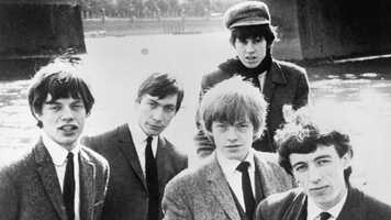"""Stewart was removed from the lineup in May 1963 at the behest of Rolling Stones publicist Andrew Loog Oldham to become the band's road manager and occasional pianist until his death in 1985. It was under the lineup of Jagger, Jones, Richards, Watts and Wyman that the band rose to fame with early hits like """"(I Can't Get No) Satisfaction."""""""
