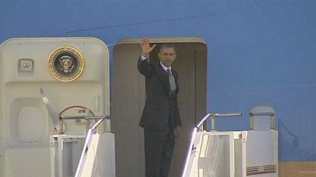 President Barack Obama boards Air Force One at Palm Beach International Airport.