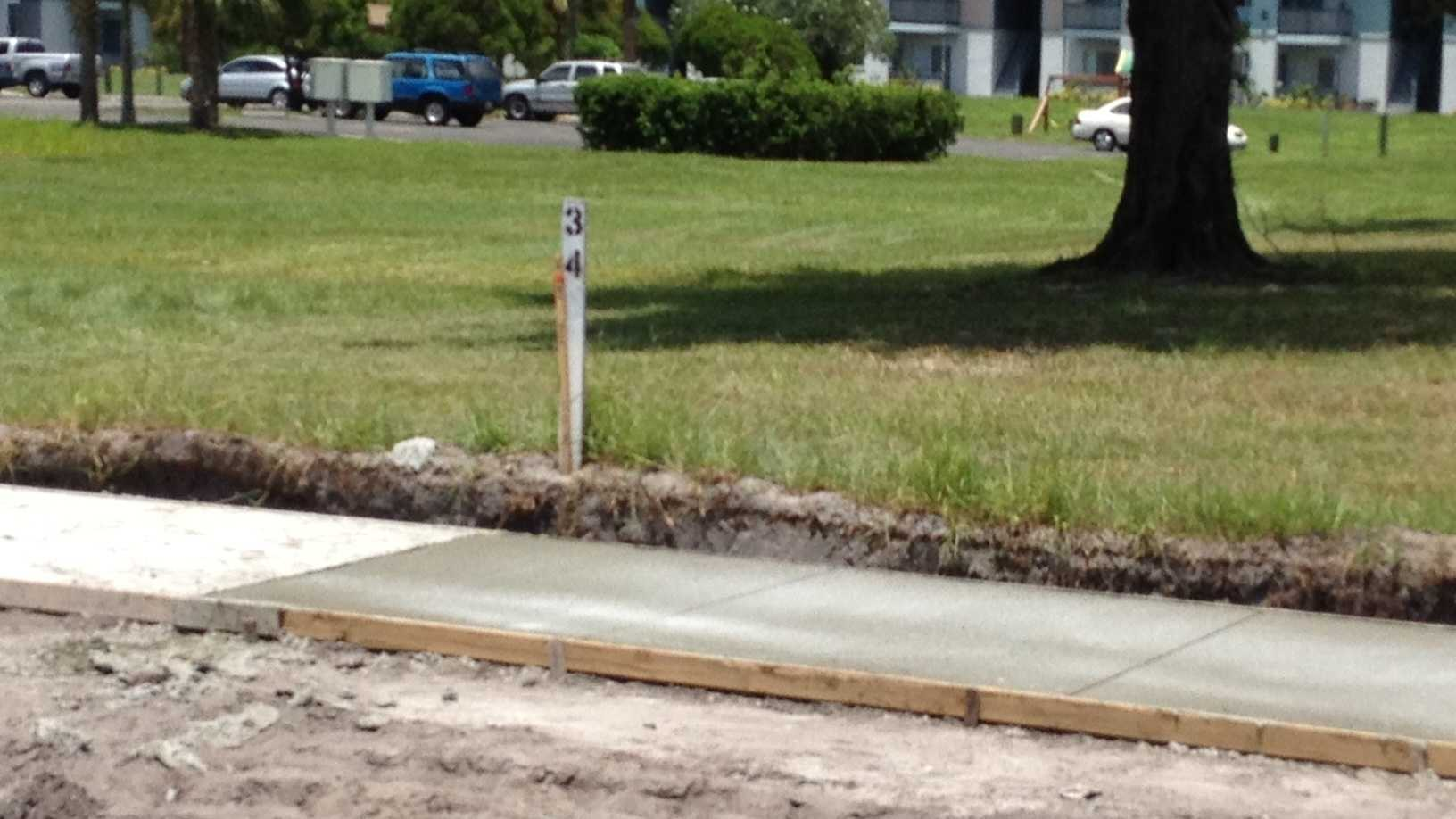 Sidewalks are being installed in a Fort Pierce neighborhood where Christopher Lupin was killed in 2005.