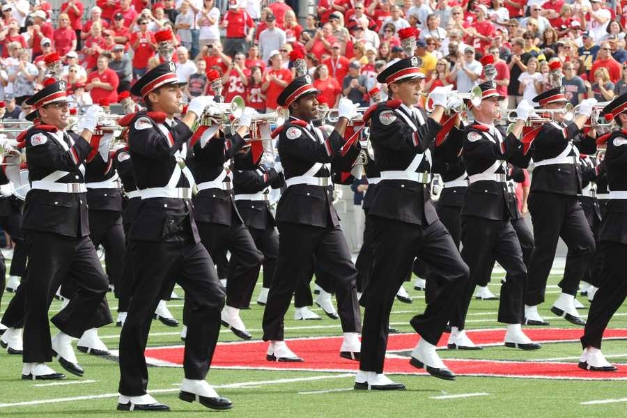 "The Ohio State University Marching Band first performed its signature formation in 1936, writing out ""Ohio"" with marching band members and creating a special place of honor for the member dotting the ""i."" (Photo: Ohio State Athletics)"