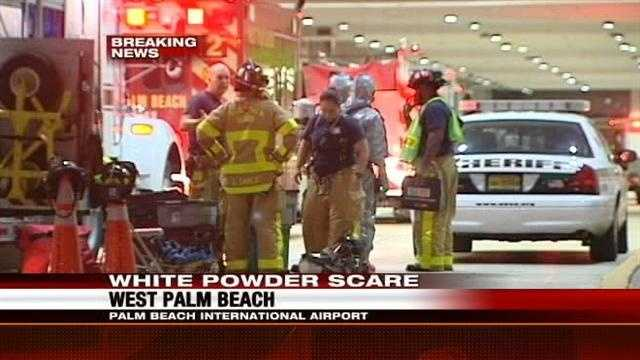 Hazmat crews are investigating a suspicious white powder found in baggage claim at PBIA.