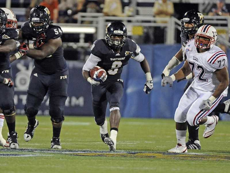 Florida International beat Florida Atlantic last season for the first time since 2005 and only the second time in school history. FIU running back Kedrick Rhodes, who eclipsed the school's single-season rushing record with 1,149 yards in 2011, rushed for 122 yards and one touchdown in last season's 41-7 win in Miami. FAU won just one game last year, but the Owls are 8-2 all-time against FIU. (Photo: Samuel Lewis/Image Reflex - FIU Athletics)