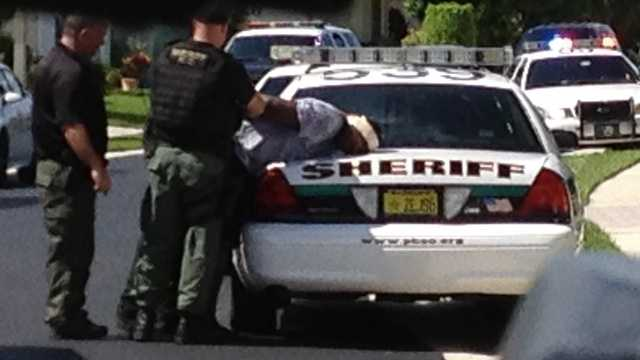 Deputies take a bank robbery suspect into custody.