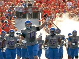 """The Boise State Broncos, who are known for their blue """"Smurf"""" turf, were banned from playing in their blue jerseys against Mountain West Conference opponents last season. (Photo: Boise State Sports Information)"""