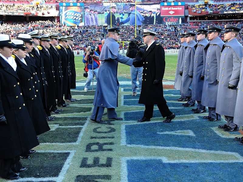 The Army vs. Navy March is a pregame tradition of the longstanding rivalry between the service academies. The Army Corps of Cadets and the Brigade of Midshipmen march onto the field before kickoff and exchange pleasantries at midfield. (Photo: U.S. Naval Academy)